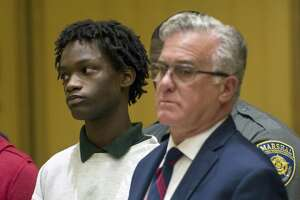 Syrus Dixon, 15, gets arraigned on a murder charge for the shooting death of Antonio Robinson inside the Stamford Superior Court House in Stamford, Conn. on Wednesday, Sept. 12, 2018.