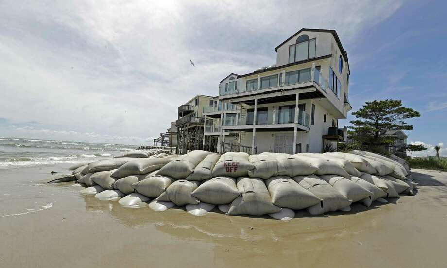 Sand bags surround homes on North Topsail Beach, N.C., Wednesday, Sept. 12, 2018, as Hurricane Florence threatens the coast. Photo: Chuck Burton /Associated Press / Copyright 2018 The Associated Press. All rights reserved