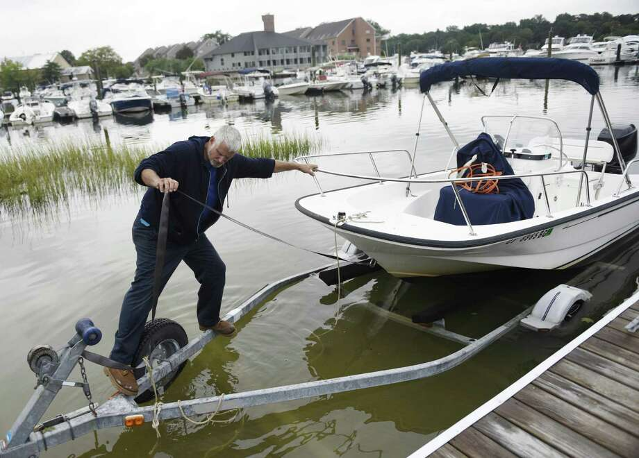 Cos Cob resident Tony Rizzi takes his boat out of the water before the anticipated rainfall from Hurricane Florence at the Mianus River Boat & Yacht Club in the Cos Cob section of Greenwich, Conn. Tuesday, Sept. 11, 2018. Hurricane Florence is expected to make landfall in the Carolinas by the end of the week, and heavy rain could hit the Greenwich area in association with the storm. Photo: Tyler Sizemore / Hearst Connecticut Media / Greenwich Time