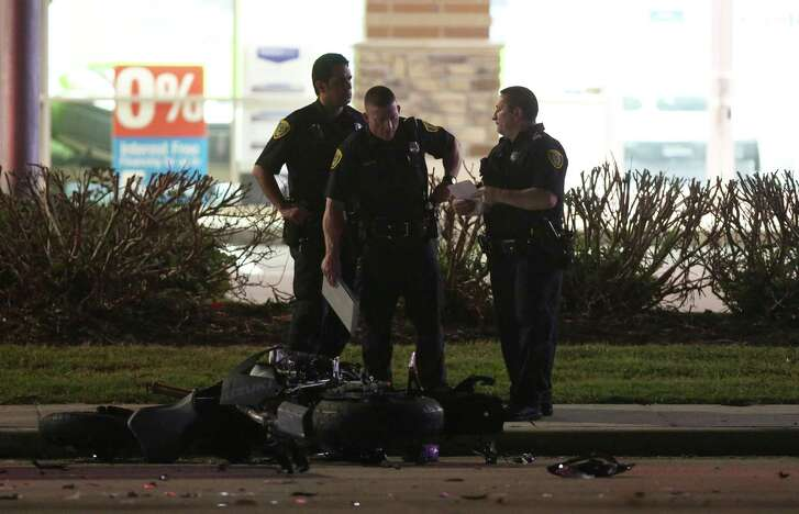 Authorities investigate the scene of a 2017 motorcycle and vehicle crash on Westheimer Road near Eldridge Parkway  in Houston. The man driving the motorcycle died.