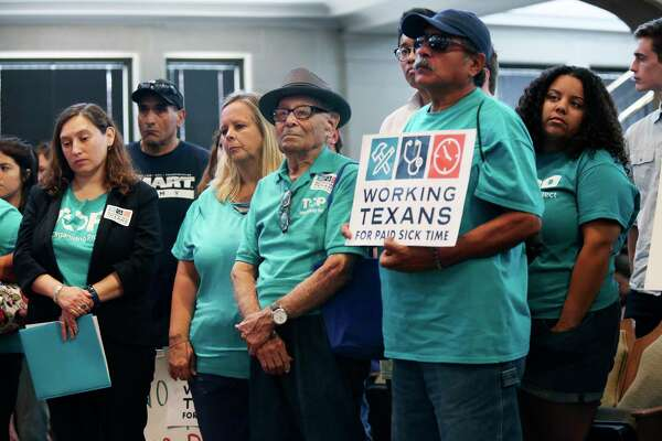 Members of Texas Organizing Project stand in support as residents speak in favor of an ordinance mandating paid sick leave during an August 2018 San Antonio City Council meeting. An array of staffing agencies and other business groups has filed a lawsuit seeking to block the policy from taking effect as scheduled Aug. 1.