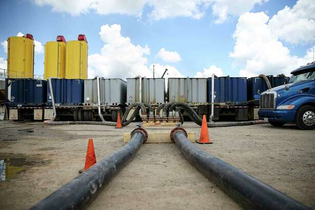 Diesel-powered trucks pump large volumes of sand and water into wells during the fracking process in the Haynesville shale in East Texas.The wells are operated by XTO Energy, a subsidiary of Exxon Mobil.