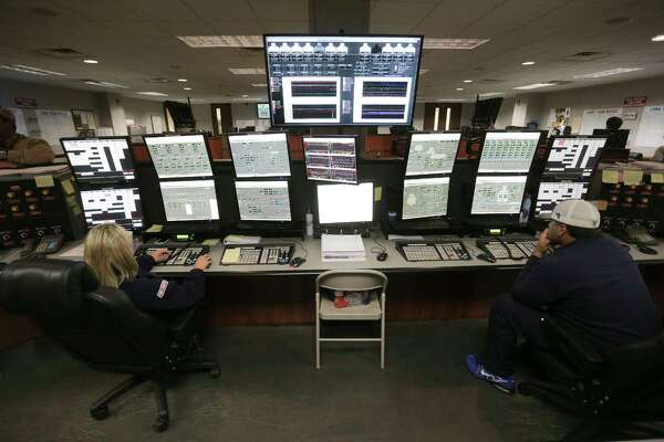 Exxon Mobil employees work in the control room in Baytown of one of the massive ethane crackers that transforms ethane into ethylene, which is the primary building block of the most common plastics.