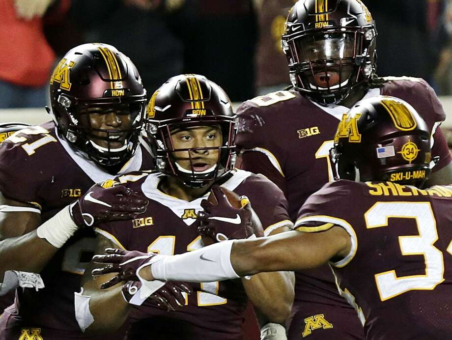 Minnesota's Antoine Winfield Jr. (11) is congratulated by teammates after intercepting a pass in the end zone by Fresno State (38) in the fourth quarter of an NCAA college football game, Saturday, Sept. 8, 2018 in Minneapolis. Minnesota defeated Fresno State 21-14. (AP Photo/Andy Clayton-King) Photo: Andy Clayton-King, FRE / Associated Press / FR51399 AP