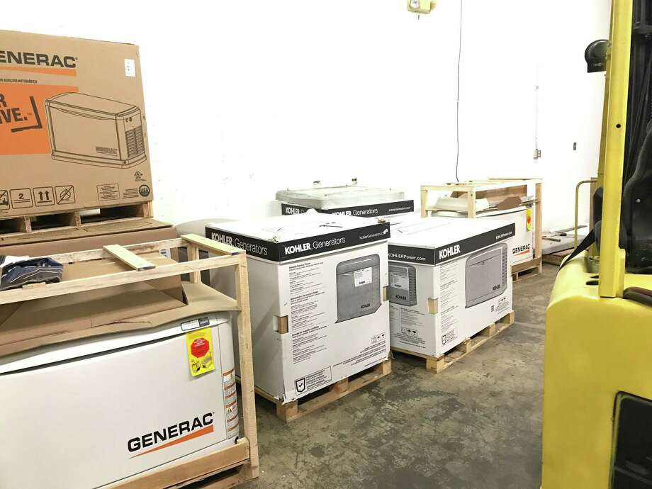 The depleted stock of home standby electrical generators in the distribution center at CT Home Generator Systems of Newington. Photo: Luther Turmelle / Hearst Connecticut Media