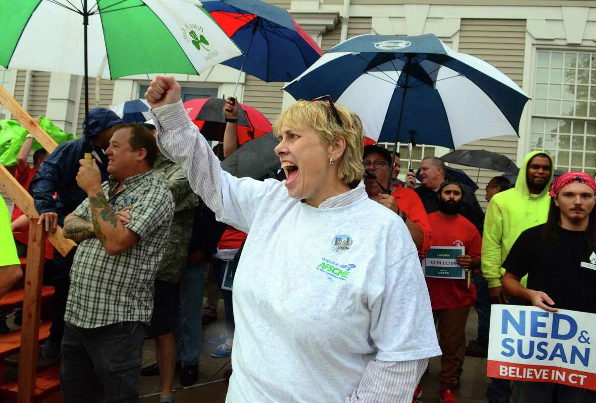 Lori Pelleteir, President of AFL-CIO in Middletown, cheers during a rally organized by area unions ahead of a gubenatorial debate between candidates Ned Lamon and Bob Stefanowski in downtown New London, Conn., on Wednesday Sept. 12, 2018.