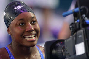 FILE - In this July 28, 2017, file photo, United States' Simone Manuel smiles after winning the gold medal in the women's 100-meter freestyle final during the swimming competitions of the World Aquatics Championships in Budapest, Hungary. Olympic champion swimmer Simone Manuel of Stanford has won the Honda Cup as the collegiate woman athlete of the year. It's the second time Stanford has had back-to-back winners. Katie Ledecky, Manuel's Olympic and collegiate teammate, won last year.  (AP Photo/Petr David Josek, File)