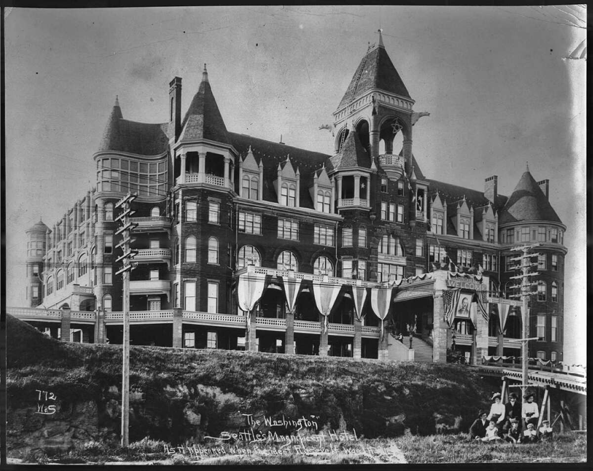 The Washington Hotel, 3rd Avenue between Stewart and Virginia, Photographed during preparations for President Teddy Roosevelt's visit in 1903. According to HistoryLink.org, The Washington Hotel, which loomed atop Denny Hill between 1890 and 1906 was only in operation for one or two summers before it was torn down to make way for the Denny regrade. After it was conceived of and built by Seattle founder Arthur Denny, economic reasons kept Denny from finishing it and the doors remained closed for 10 years until James Moore purchased it around 1903. President Teddy Roosevelt requested the hotel open for his one-night stay in Seattle. Courtesy of Seattle Municipal Archives