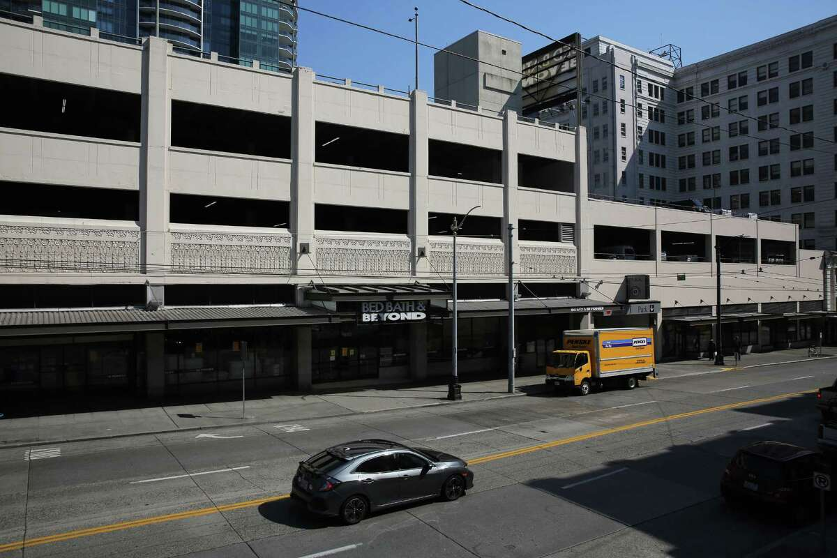 A soon-to-be-closing Bed Bath and Beyond and parking garage now hold the space that was home to the Washington Hotel over a century ago. Photographed Sept. 5, 2018. (Genna Martin, SeattlePI)