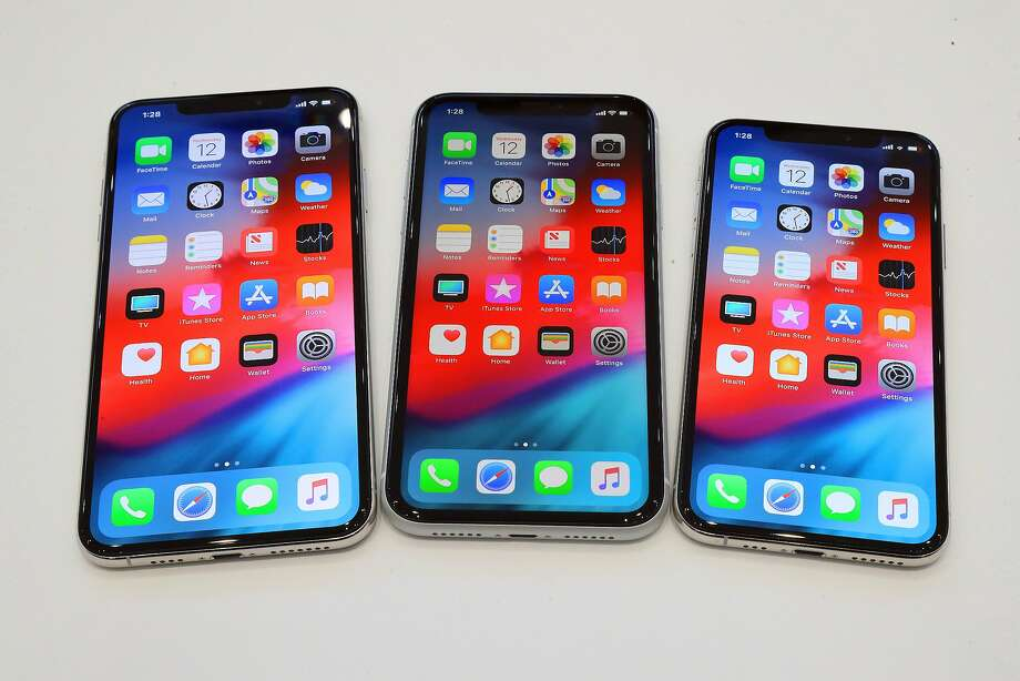 From left, the iPhone XS Max, the iPhone XR, and the iPhone XS., all unveiled at Apple's new product launch event in Cupertino, Calif., Sept. 12, 2018. Once again, Apple has made its phones a bit larger and faster, and is charging more for them. (Jim Wilson/The New York Times) Photo: Jim Wilson / New York Times