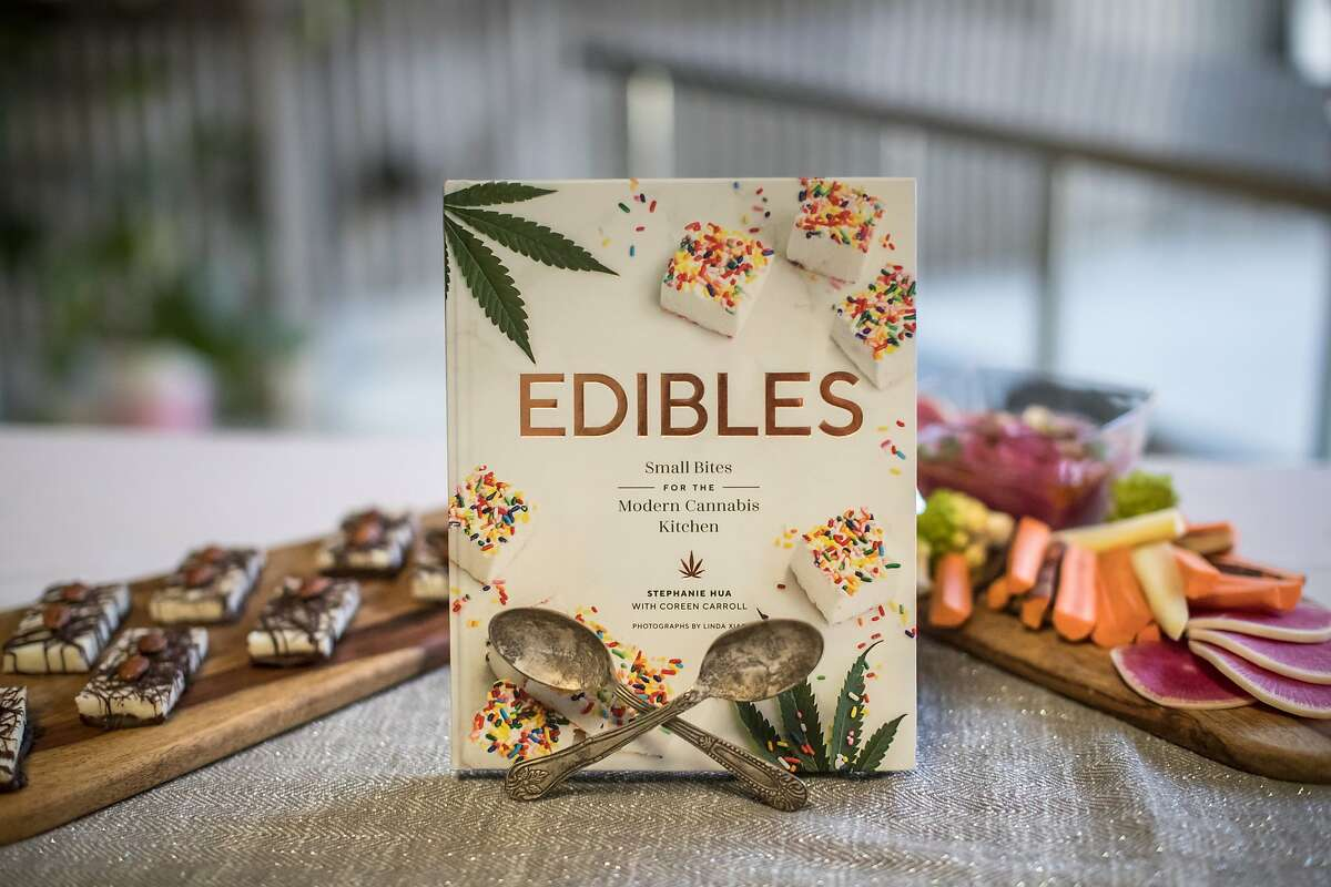 A soon to be released book by Stephanie Hua and Coreen Carroll, Edibles: Small Bites for the Modern Cannabis Kitchen is displayed with Joyful Almond Coconut Bars (left) and Roasted Beet Hummus on Thursday, Sept. 6, 2018, in San Francisco, Calif.
