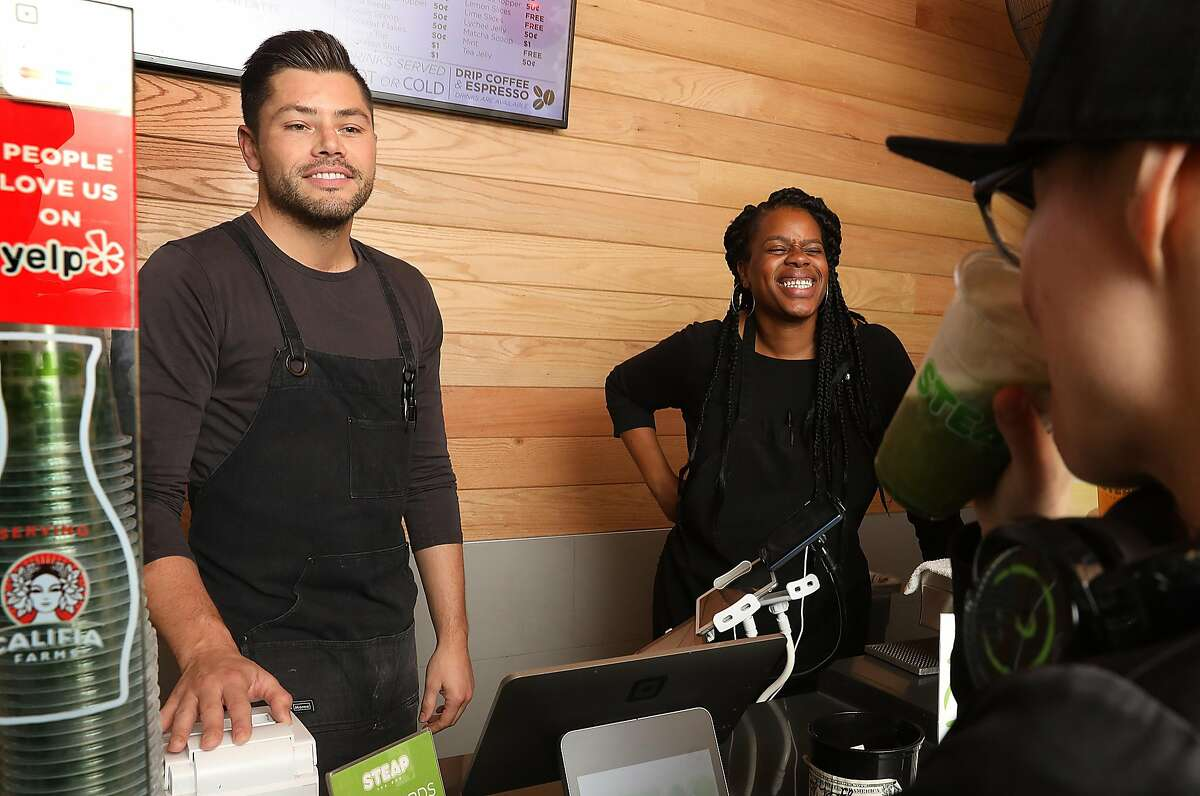 Founder Emil DeFrancesco (left) talks to a customer about no longer using CBD infused honey to sweeten his Green Queen matcha tea drink on Monday, Sept. 10, 2018 in San Francisco, Calif. Manager Erika Simpson is at right. CBD, the non-psychoactive component of cannabis has become suddenly illegal.