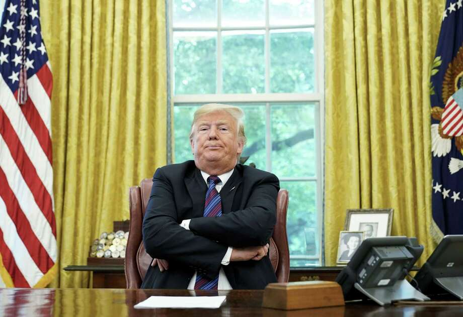 "Readers debate the president's criticism of the news media, one noting the preponderance of ""negative news"" published about him, the other the president's misuse of the term ""fake news."" Photo: MANDEL NGAN /AFP /Getty Images / AFP or licensors"