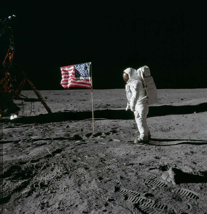 20 July 1969) --- Astronaut Edwin E. Aldrin Jr., lunar module pilot of the first lunar landing mission, poses for a photograph beside the deployed United States flag during an Apollo 11 extravehicular activity (EVA) on the lunar surface. The Lunar Module (LM) is on the left, and the footprints of the astronauts are clearly visible in the soil of the moon. (NASA)