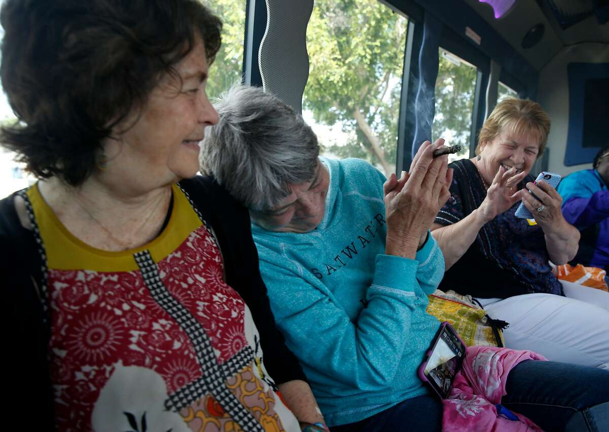 Sisters Henrietta Dills, Mary Atkins and Lori Probst share a joint as they head for the next stop on their tour, the Riggers Loft Wine Co., on the Weed & Wine Tour.