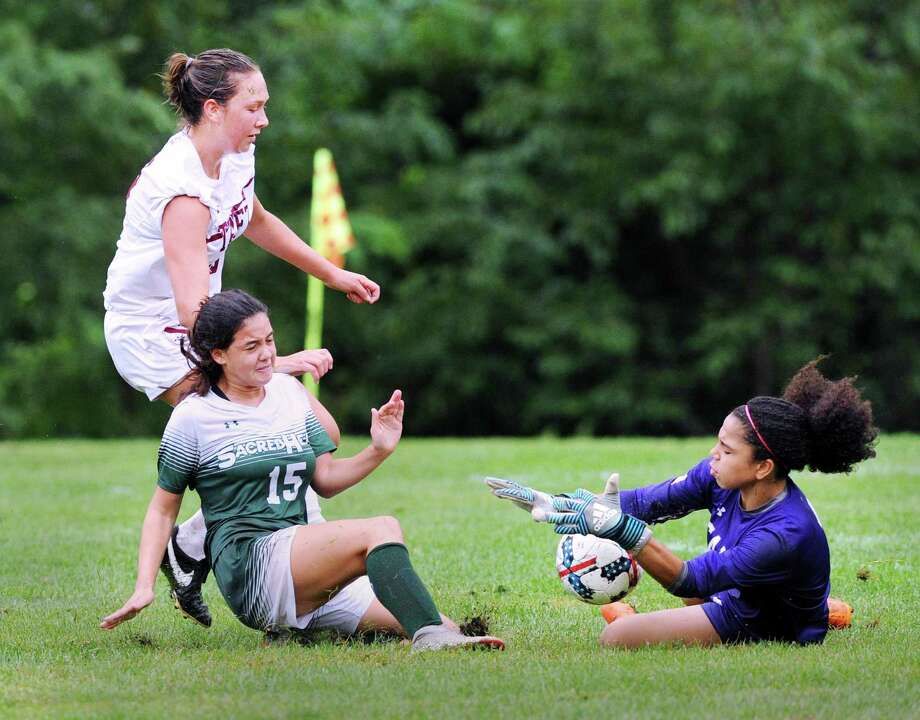 Taft School goalie Claudia Torres, right, stops a point-blank shot by Lara Patricio (#15) of Sacred Heart Greenwich during the girls high school soccer match between Sacred Heart Greenwich and Taft School at Greenwich, Conn., Wednesday, Sept. 12, 2018. Photo: Bob Luckey Jr. / Hearst Connecticut Media / Greenwich Time
