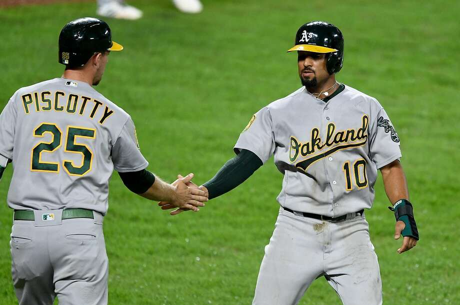 Stephen Piscotty #25 and Marcus Semien #10 of the Oakland Athletics celebrate after scoring in the third inning against the Baltimore Orioles at Oriole Park at Camden Yards on September 12, 2018 in Baltimore, Maryland. Photo: Greg Fiume / Getty Images