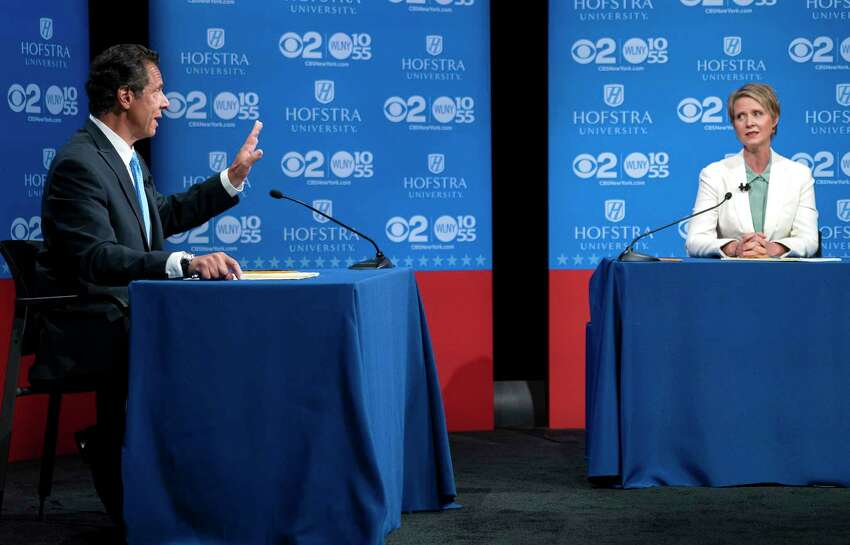 FILE - In this Aug. 29, 2018, file photo, New York Gov. Andrew Cuomo answers a question as his Democratic gubernatorial challenger, Cynthia Nixon, looks on during a debate at Hofstra University in Hempstead, N.Y. Nixon is mostly right in her claim that Cuomo allowed Republicans draw redistricting lines after 2010 census. (AP Photo/Craig Ruttle, Pool, File)