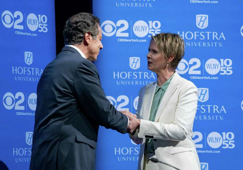 Gov. Andrew Cuomo and primary opponent Cynthia Nixon shake hands before their lone debate. (Photo by Craig Ruttle-Pool/Getty Images)