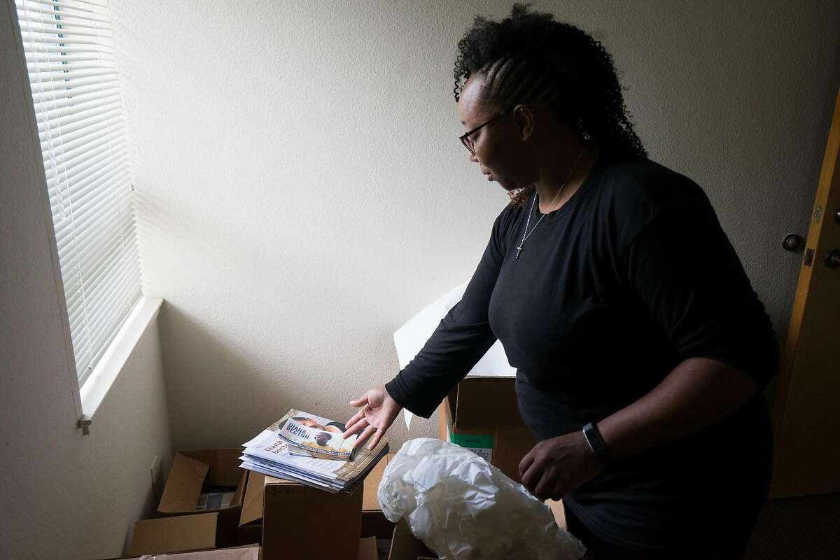 Tamisha Walker, 36, of Antioch, sorts through fliers at the Safe Return Project office in Pittsburg, Calif. on Wednesday, September 12, 2018. Walker, a co-founder and executive director of the Safe Return Project says her goal is to,