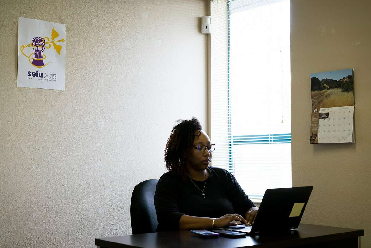 Tamisha Walker, 36, of Antioch, works at the Safe Return Project office in Pittsburg, Calif. on Wednesday, September 12, 2018. Walker, a co-founder and executive director of the Safe Return Project says her goal is to,