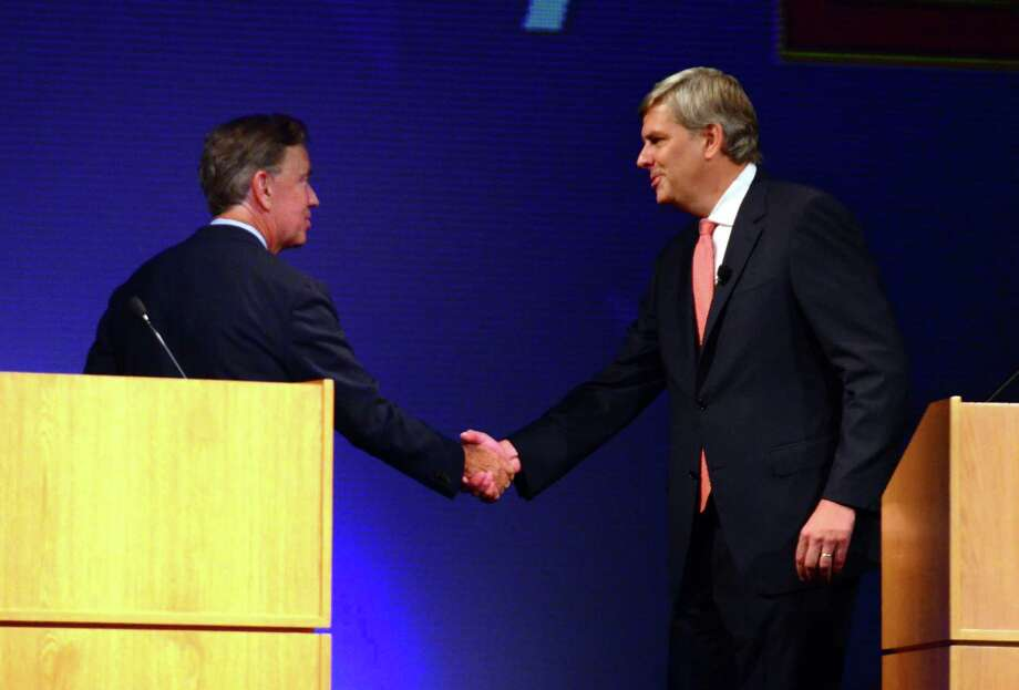Democrat Ned Lamont, left, shakes hands with republican candidate Bob Stefanowski at the conclusion of a gubernatorial debate at the Garde Arts Center in downtown New London, Conn., on Wednesday Sept. 12, 2018. Photo: Christian Abraham / Hearst Connecticut Media / Connecticut Post