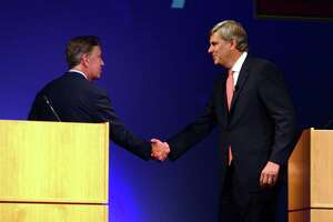 Democrat Ned Lamont, left, shakes hands with republican candidate Bob Stefanowski at the conclusion of a gubernatorial debate at the Garde Arts Center in downtown New London, Conn., on Wednesday Sept. 12, 2018.