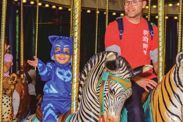 A costumed youngster rides the carousel during a previous Boo at the Zoo.