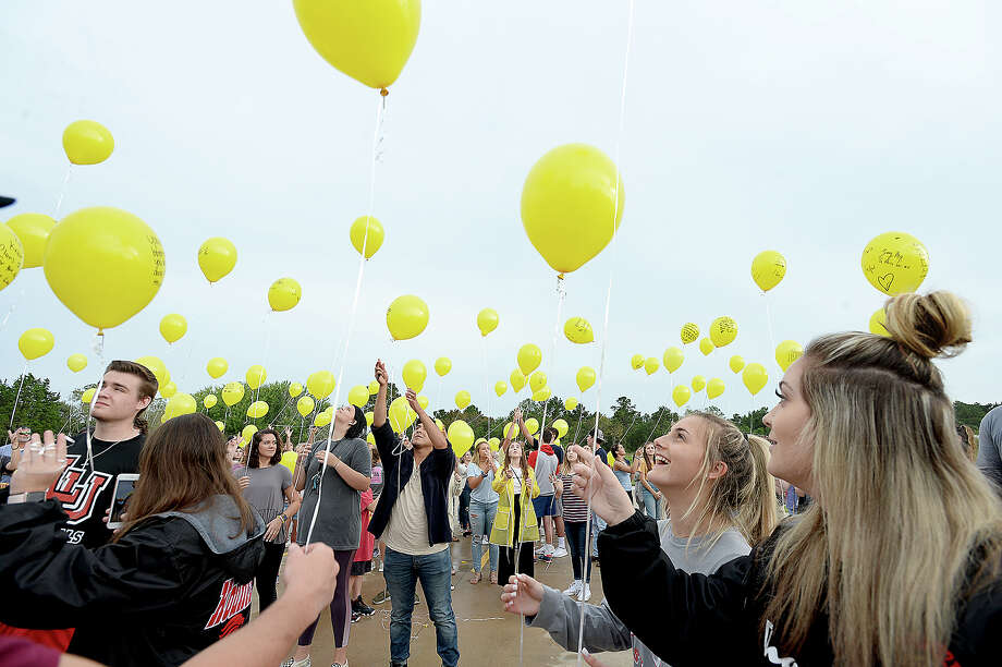 Attendees  look skyward as they release their balloons, each bearing messages of remembrance and hope, during a memorial balloon release at Praise Church in honor of the three teens killed in a car accident Sunday in Hardin County. 2018 Hardin-Jefferson graduate Alix Neel, and 2018 West Hardin graduates Garrett Saulters and Caringtin Mosley were remembered by friends, family and members of the community at the vigil. Visitations and funerals for the teens began Wednesday and continue through Friday.  Wednesday, September 12, 2018 Kim Brent/The Enterprise Photo: Kim Brent/The Enterprise