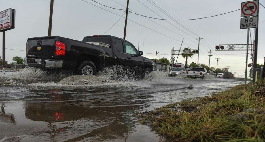 Water floods the sidewalk near Arkansas Avenue and Guadalupe Street after heavy rainfall throughout Laredo on Thursday, Sept. 6, 2018. Photo: Danny Zaragoza /Laredo Morning Times