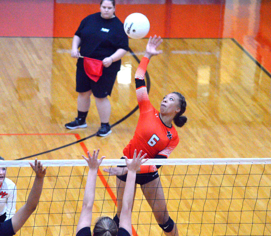 Edwardsville sophomore Alexa Harris goes up for a kill during the second game of Wednesday's match against Incarnate Word Academy at EHS. Photo: Scott Marion
