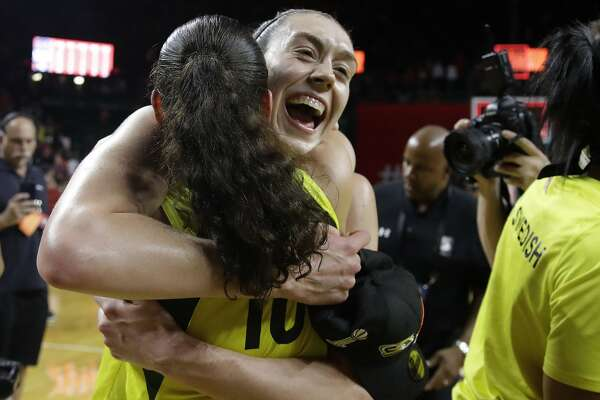 Seattle Storm forward Breanna Stewart (30) hugs teammate Sue Bird (10) on the court after winning Game 3 of the WNBA basketball finals, Wednesday, Sept. 18 2018, in Fairfax, Va. The Seattle Storm defeated the Washington Mystics 98-82. (AP Photo/Carolyn Kaster)