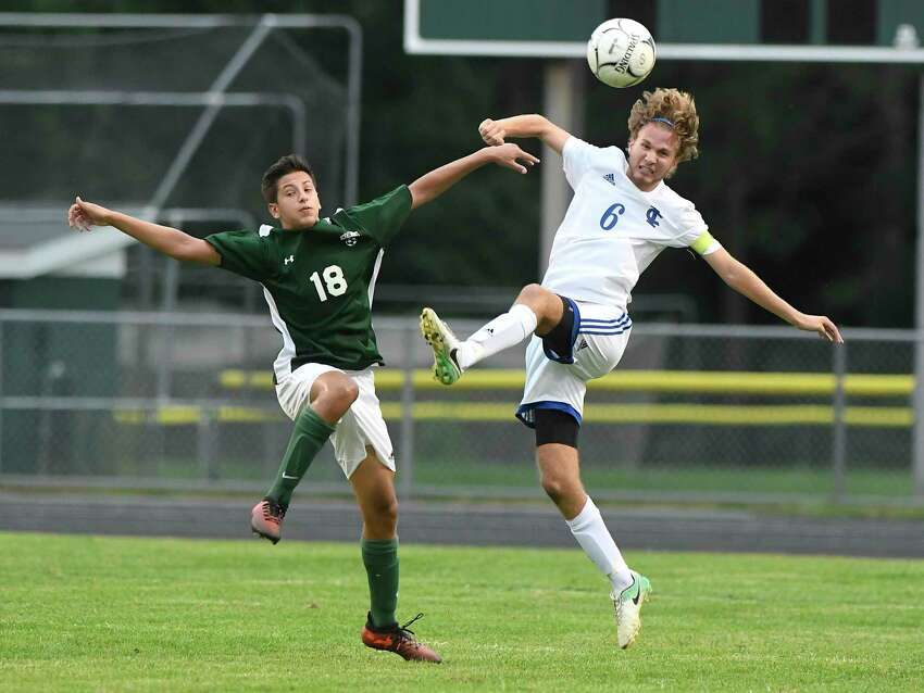 Schalmont's Dan Tommasone (18) and Ichabod Crane's Jack Kirby (6) battle for control of the ball during a Section II boys' soccer game Wednesday, Sept. 12, 2018, in Rotterdam, N.Y. (Hans Pennink / Special to the Times Union)