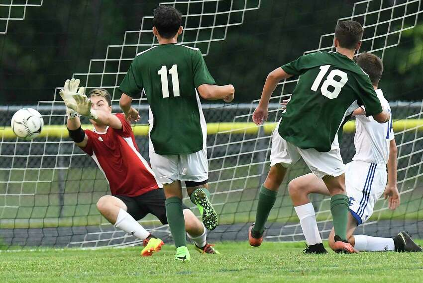 Ichabod Crane goalkeeper Spencer Bates ,left, makes a save against Schalmont during a Section II boys' soccer game Wednesday, Sept. 12, 2018, in Rotterdam, N.Y. (Hans Pennink / Special to the Times Union)