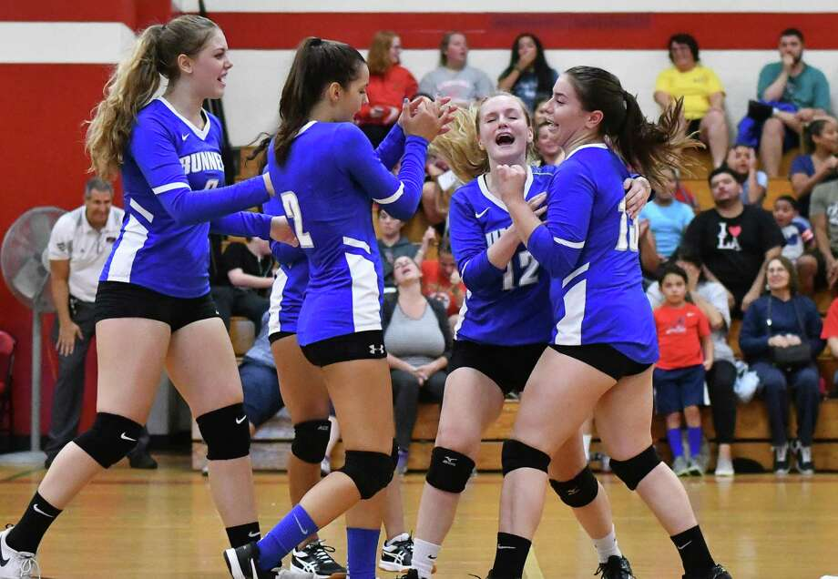 The Bunnell Bulldogs volleyball team reacts after winning a game during a match against the Stratford Red Devils on Wednesday September 12, 2018 at Stratford High School in Stratford, Connecticut. Photo: Gregory Vasil / For Hearst Connecticut Media / Connecticut Post Freelance