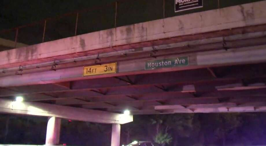 A big rig struck the Houston Avenue bridge over the Katy Freeway on Wednesday night. Photo: Jay R. Jordan, Metro Video