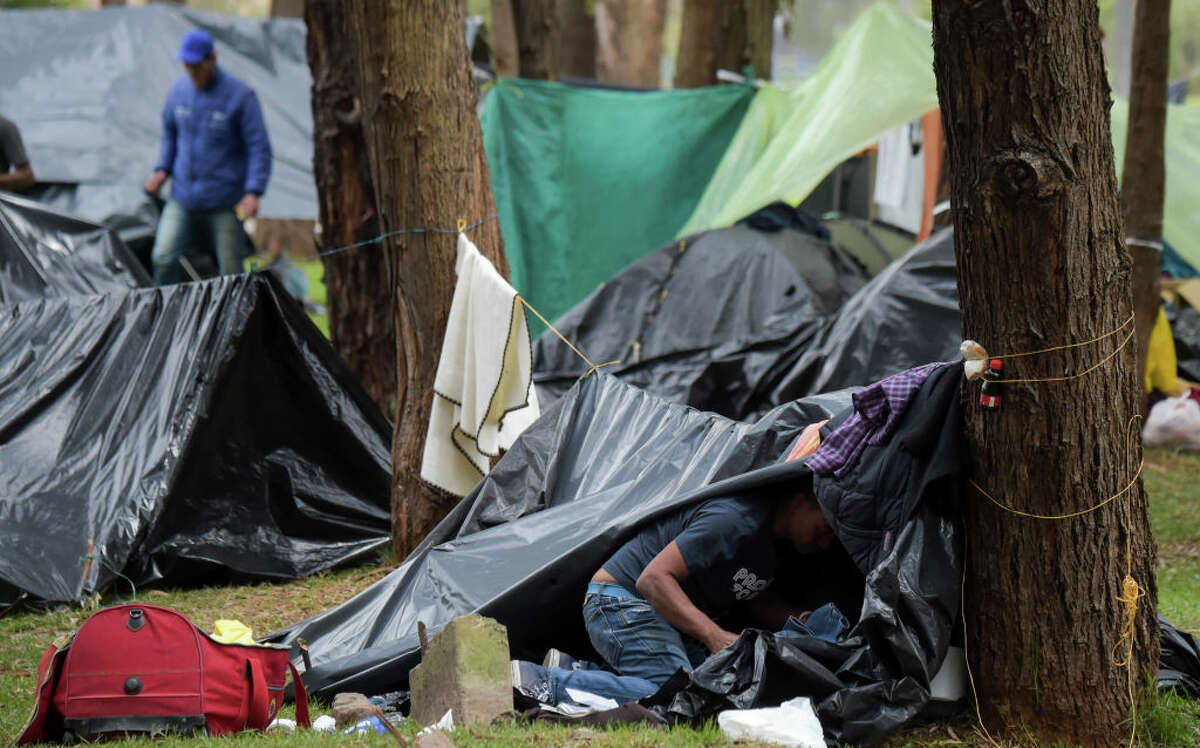 A Venezuelan migrant is pictured at an improvised camp near a bus terminal in Bogota on September 11, 2018. - More than one hundred migrants set up a makeshift camp in a wooded area, near the bus terminal where they arrived, whether to stay in Colombia or to continue their journey. (Photo by Raul ARBOLEDA / AFP) (Photo credit should read RAUL ARBOLEDA/AFP/Getty Images)