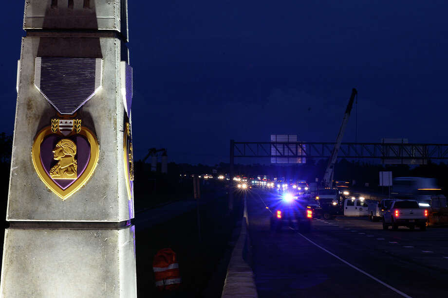 Workers begin to remove concrete barriers on the Purple Heart Memorial Bridge across the Neches River on Wednesday evening. TXDOT expected to open the new westbound lanes overnight.  Photo taken Wednesday 9/12/18 Ryan Pelham/The Enterprise Photo: Ryan Pelham/The Enterprise / ?2018 The Beaumont Enterprise