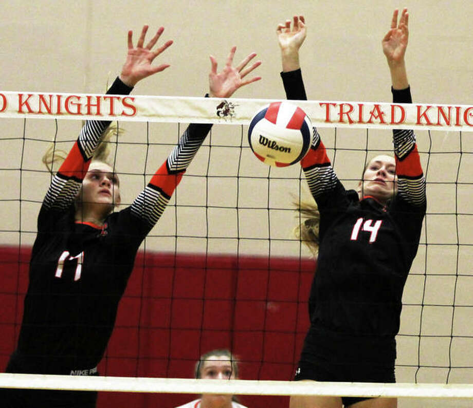 Edwardsville's Maddie Isringhausen (right) scores off a block assisted by teammate Storm Suhre during the Tigers' victory over Triad on Monday night in Troy. The Tigers were back on their home court in Edwardsville on Wednesday night and dropped to 7-6 with a loss to Incarnate Word Academy. Photo: Greg Shashack / The Telegraph