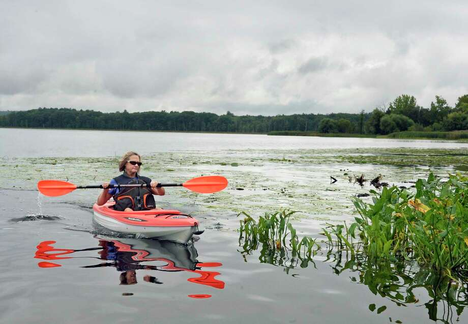 Marsha Krist of Guilderland kayaks around Round Lake on a quiet Thursday morning Sept. 13, 2018 in Round Lake, NY.  (John Carl D'Annibale/Times Union) Photo: John Carl D'Annibale, Albany Times Union