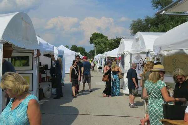 Visitors browse artists' tents at a previous Edwardsville Art Fair.