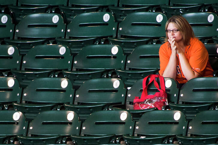 Astros fan Greis Perez had plenty of room around her in section 124 as she watched her team face the Minnesota Twins at Minute Maid Park on Monday, Sept. 2, 2013, in Houston