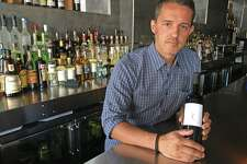 Chef Rui Correia, who was born in Porto, Portugal, arrived in the United States decades ago as a child. He pursued a culinary career, through which he shares the cuisine of his homeland. He stands at the bar of Douro, the restuarant he opened 10 years ago in Greenwich, Connecticut, on Monday, Aug. 27, 2018. A year or so ago, he started his own label of Portugal wine.