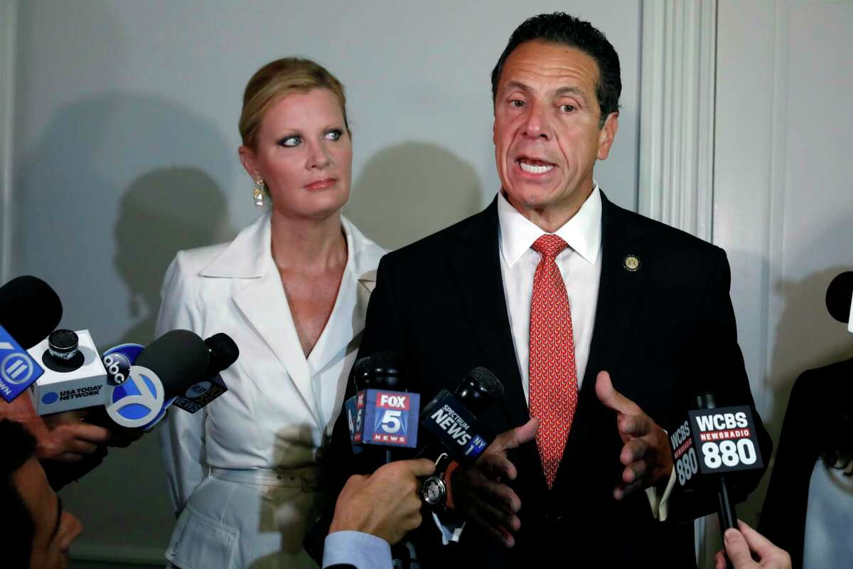 New York Gov. Andrew Cuomo is accompanied by his girlfriend Sandra Lee as he talks to the press after casting his primary election ballot, at the Presbyterian Church of Mount Kisco, in Mount Kisco, N.Y., Thursday, Sept. 13, 2018.