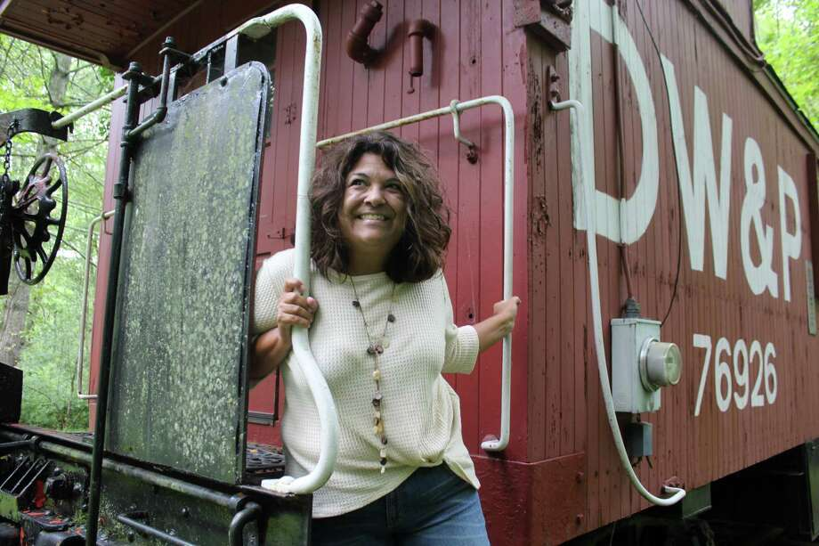 Film and television writer, teacher, and instructor Gigi New stands outside her caboose office at her Westport home on Sept. 7. Photo: Sophie Vaughan / Hearst Connecticut Media / Westport News