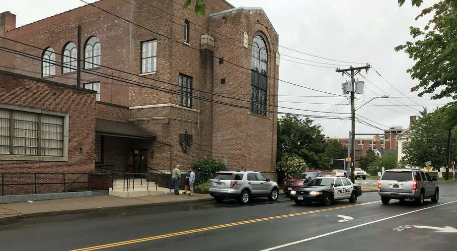 Police investigate the discovery of a letter containing white powder that was delivered to Congregation Adath Israel on Broad Street in Middletown Wednesday afternoon. Photo: Brian Foley Photo