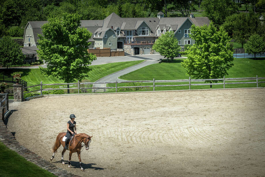Double H Farm, an 87-acre home and equestrian facility in Ridgefield, is owned by the late wife of a top railway executive, who passed away last year. The property features amenities for 43 horses, along with a main house, staff apartments, barns and two guest houses, one from the early 1700s. It is on the market for $33 million. Photo: Steve Rossi, Contributed / © SR Photo, LLC All Rights Reserved The News-Times Contributed
