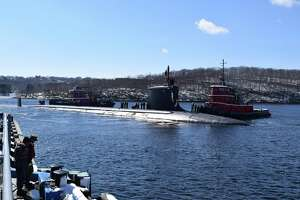 The USS Minnesota makes its way to the pier at Naval Submarine Base New London in Groton in March. An upcoming summit not far from the base will try to establish closer ties between the state companies and Australia.