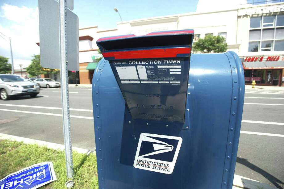 The mailbox across the street from Ridgeway Shopping Center on Summer St. has been victimized by thiefs who used sticky paper and string to fish letters out, including tax payments and checks. Photographed in Stamford, Conn. on Tuesday, Aug. 14, 2018. Photo: File Photo / Stamford Advocate