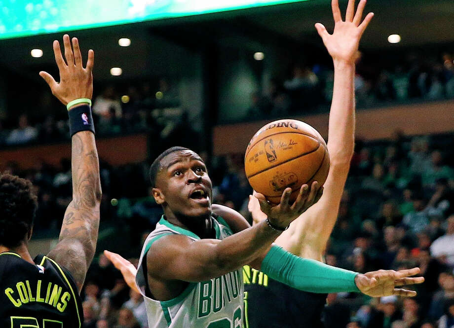 FILE - In this April 8, 2018, file photo, Boston Celtics' Jabari Bird, center, drives to the basket past Atlanta Hawks' John Collins (20) during the fourth quarter of an NBA basketball game in Boston. Bird is facing several charges following a domestic incident in which a victim was injured, police said. (AP Photo/Michael Dwyer, File) Photo: Michael Dwyer, Associated Press / AP2018